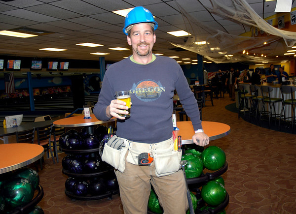 Gary Bresien works the room at Friday's Bowling for Breast Cancer fundraiser at Chipper Lanes in Broomfield.<br /> October 30, 2009<br /> Staff /Dylan Otto Krider