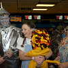 Greg Bensen, Anna Bensen carries their 9-month old Luke as grandma Marth Pearce holds the tail at Friday's Bowling for Breast Cancer fundraiser at Chipper Lanes in Broomfield.<br /> October 30, 2009<br /> Staff /Dylan Otto Krider