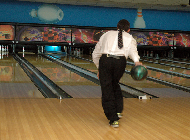 Graham Garlick bowls backwards at Friday's Bowling for Breast Cancer fundraiser at Chipper Lanes in Broomfield.<br /> October 30, 2009<br /> Staff /Dylan Otto Krider