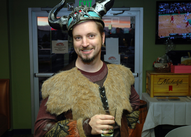 Viking Jake Sutton down's the ale at Friday's Bowling for Breast Cancer fundraiser at Chipper Lanes in Broomfield.<br /> October 30, 2009<br /> Staff /Dylan Otto Krider