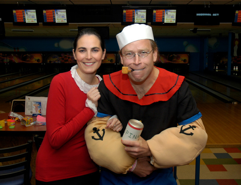 Olive Oil (Carolina Piloniea) goes great with Popeye's (Chris Sweeney) spinach at Friday's Bowling for Breast Cancer fundraiser at Chipper Lanes in Broomfield.<br /> October 30, 2009<br /> Staff /Dylan Otto Krider