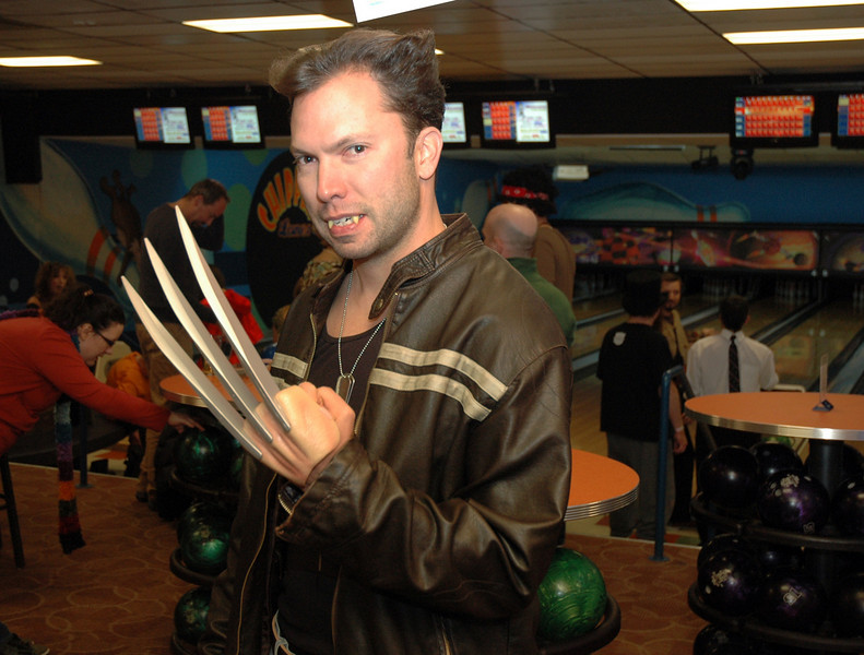 Dave Mayer bears his teeth at Friday's Bowling for Breast Cancer fundraiser at Chipper Lanes in Broomfield.<br /> October 30, 2009<br /> Staff /Dylan Otto Krider