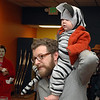 Kevin Olson's got a cat on his back (9-month-old Willa) at Friday's Bowling for Breast Cancer fundraiser at Chipper Lanes in Broomfield.<br /> October 30, 2009<br /> Staff /Dylan Otto Krider