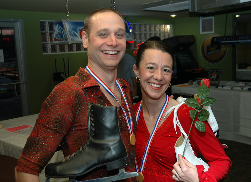 Foreker VP Darek Olson and Beth Olson go for gold at Friday's Bowling for Breast Cancer fundraiser at Chipper Lanes in Broomfield.<br /> October 30, 2009<br /> Staff /Dylan Otto Krider