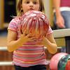 Avery Prochazka, 5, looks over the bowling ball while bowling for North Metro Fire during the Bowl for a Precious Child Broomfield Police vs. North Metro Fire Rescue District at Chippers Lanes on Sunday.<br /> <br /> April 11, 2010<br /> Staff photo/David R. Jennings