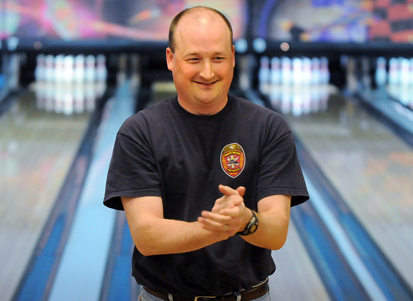 Richard Schermerhorn, North Metro Fire Rescue, accepts applause for his bowling efforts during the Bowl for a Precious Child Broomfield Police vs. North Metro Fire Rescue District at Chippers Lanes on Sunday.<br /> <br /> April 11, 2010<br /> Staff photo/David R. Jennings