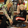 Elizabeth Licht helps her son Clayton, 5, with his bowling shoes before bowling at the Bowl for a Precious Child Broomfield Police vs. North Metro Fire Rescue District at Chippers Lanes on Sunday.<br /> <br /> April 11, 2010<br /> Staff photo/David R. Jennings