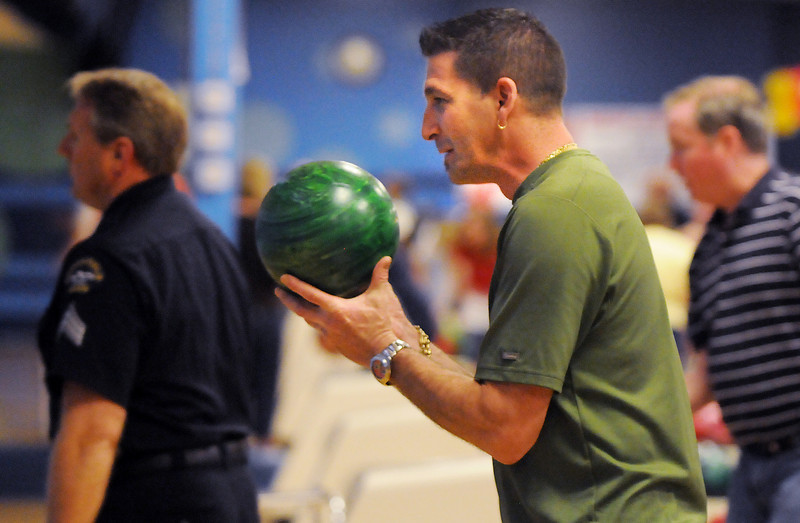 Frank Canino, North Metro Fire Rescue, eyes the lane while bowling during the Bowl for a Precious Child Broomfield Police vs. North Metro Fire Rescue District at Chippers Lanes on Sunday.<br /> <br /> April 11, 2010<br /> Staff photo/David R. Jennings