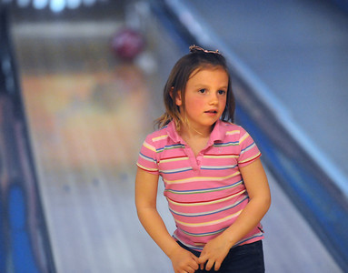 Avery Prochazka, 5, looks back at her parents after releasing a bowling ball for North Metro Fire during the Bowl for a Precious Child Broomfield Police vs. North Metro Fire Rescue District at Chippers Lanes on Sunday.  April 11, 2010 Staff photo/David R. Jennings