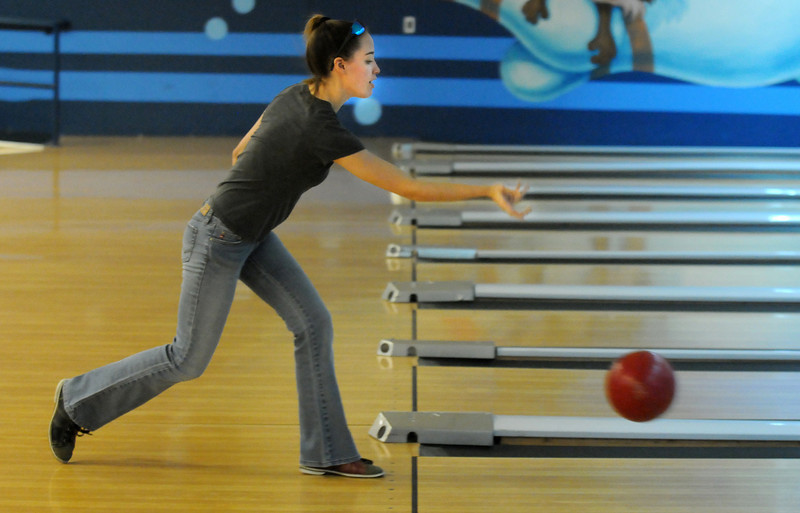 Amber Bryan bowls for North Metro Fire during the Bowl for a Precious Child Broomfield Police vs. North Metro Fire Rescue District at Chippers Lanes on Sunday.<br /> <br /> April 11, 2010<br /> Staff photo/David R. Jennings