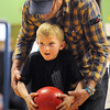 BE0415BOWL02<br /> Paul Licht helps his son Clayton, 5, during the Bowl for a Precious Child Broomfield Police vs. North Metro Fire Rescue District at Chippers Lanes on Sunday.<br /> <br /> April 11, 2010<br /> Staff photo/David R. Jennings