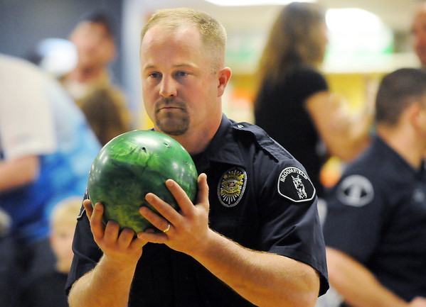 Broomfield officer Jason Collins bowls during the Bowl for a Precious Child Broomfield Police vs. North Metro Fire Rescue District at Chippers Lanes on Sunday.<br /> <br /> April 11, 2010<br /> Staff photo/David R. Jennings
