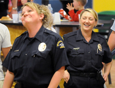 Broomfield officers Jennifer King, left, and Enea Hempelmann joke with each other during the Bowl for a Precious Child Broomfield Police vs. North Metro Fire Rescue District at Chippers Lanes on Sunday.  April 11, 2010 Staff photo/David R. Jennings