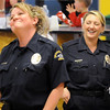 Broomfield officers Jennifer King, left, and Enea Hempelmann joke with each other during the Bowl for a Precious Child Broomfield Police vs. North Metro Fire Rescue District at Chippers Lanes on Sunday.<br /> <br /> April 11, 2010<br /> Staff photo/David R. Jennings