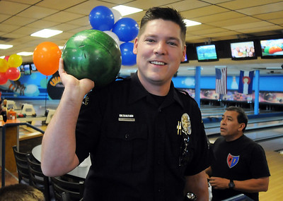 Broomfield Police officer Shawn Laughlin holds a bowling ball before the tournament, Bowl for a Precious Child Broomfield Police vs. North Metro Fire Rescue District, begins at Chippers Lanes on Sunday.  April 11, 2010 Staff photo/David R. Jennings