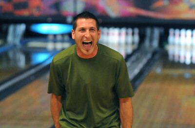 Frank Canino, North Metro Fire Rescue,  laughs after making a gutter ball during the Bowl for a Precious Child Broomfield Police vs. North Metro Fire Rescue District at Chippers Lanes on Sunday.  April 11, 2010 Staff photo/David R. Jennings