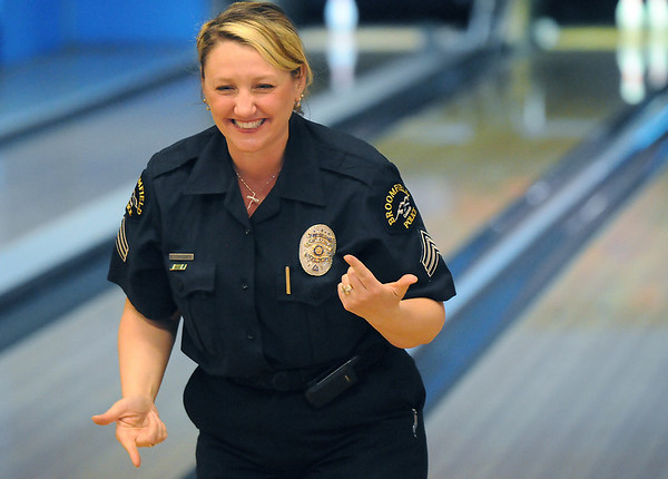 Enea Hempelmann, Broomfield Police, reacts after throwing the ball during the Bowl for a Precious Child Broomfield Police vs. North Metro Fire Rescue District at Chippers Lanes on Sunday.<br /> <br /> April 11, 2010<br /> Staff photo/David R. Jennings
