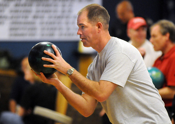 John Daughtery, North Metro Fire Rescue, bowls during the Bowl for a Precious Child Broomfield Police vs. North Metro Fire Rescue District at Chippers Lanes on Sunday.<br /> <br /> April 11, 2010<br /> Staff photo/David R. Jennings