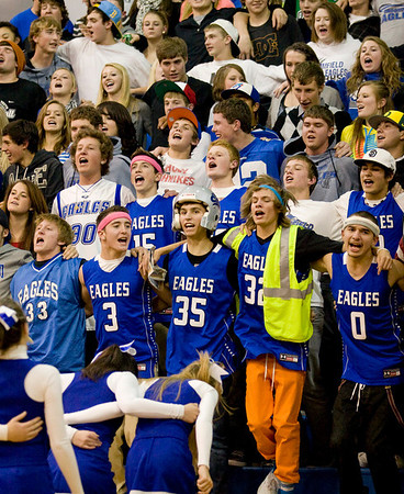 Eagle fans cheer on their team during Friday's game against Lewis Palmer.<br /> <br /> <br /> December 2, 2011<br /> photo by Matt Kelley