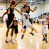 Broomfield's Austin Wood, #15, goes up for a basket  during Friday's game against Lewis Palmer.<br /> <br /> <br /> December 2, 2011<br /> photo by Matt Kelley