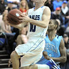 Broomfield's Austin Wood goes to the basket past Widefield's David Ajavon during Friday's state playoff game at Broomfield.<br /> February 24, 2012 <br /> staff photo/ David R. Jennings