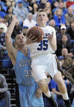 Broomfield's Brandon Little goes to the basket past Widefield's Robert Pace during Friday's state playoff game at Broomfield.<br /> February 24, 2012 <br /> staff photo/ David R. Jennings
