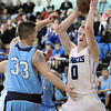 Broomfield's Dan Perse rebounds the ball against Widefield's Robert Pace during Friday's state playoff game at Broomfield.<br /> February 24, 2012 <br /> staff photo/ David R. Jennings