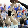 Broomfield's Brandon Little goes to the basket against Widefield's Alan Herndon during Friday's state playoff game at Broomfield.<br /> February 24, 2012 <br /> staff photo/ David R. Jennings