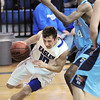 Broomfield's Austin Wood drives the ball around Widefield's David Ajavon during Friday's state playoff game at Broomfield.<br /> February 24, 2012 <br /> staff photo/ David R. Jennings