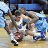 Broomfield's Austin Wood fights for possession of the ball with Widefield's Charles Evans, right, and David Ajavon during Friday's state playoff game at Broomfield.<br /> February 24, 2012 <br /> staff photo/ David R. Jennings