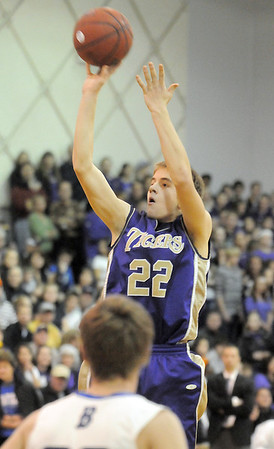 Holy Family's David Sommers shoots the ball against Broomfield during Saturday's cross-town rivalry game at Broomfield.<br /> January 28, 2012<br /> staff photo/ David R. Jennings