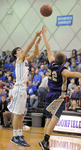 Broomfield's Nick Ongarato shoots the ball over Holy Family's David Sommers during Saturday's cross-town rivalry game at Broomfield. January 28, 2012 staff photo/ David R. Jennings