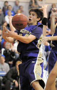 Holy Family's Devlin Granberg grabs a loose ball from Broomfield during Saturday's cross-town rivalry game at Broomfield. January 28, 2012 staff photo/ David R. Jennings