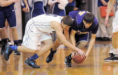 Broomfield's Nate Roylance and Holy Family's Devlin Granberg scramble after a loose ball during Saturday's cross-town rivalry game at Broomfield. January 28, 2012 staff photo/ David R. Jennings