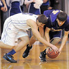 Broomfield's Nate Roylance and Holy Family's Devlin Granberg scramble after a loose ball during Saturday's cross-town rivalry game at Broomfield.<br /> January 28, 2012<br /> staff photo/ David R. Jennings