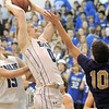 Broomfield's Dan Perse goes to the basket  against Holy Family's Tanner Stuhr during Saturday's cross-town rivalry game at Broomfield.<br /> January 28, 2012<br /> staff photo/ David R. Jennings