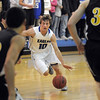 "Broomfield's Austin Wood dribbles the ball downcourt against Thompson Valley during Thursday's game in the Eagle gym at Broomfield High.<br /> More photos please see  <a href=""http://www.broomfieldenterprise.com"">http://www.broomfieldenterprise.com</a><br /> December 15, 2011<br /> Staff photo/ David R. Jennings"