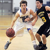 "Broomfield's Austin Wood dribbles the ball against Thompson Valley's Mike Olivas during Thursday's game in the Eagle gym at Broomfield High.<br /> More photos please see  <a href=""http://www.broomfieldenterprise.com"">http://www.broomfieldenterprise.com</a><br /> December 15, 2011<br /> Staff photo/ David R. Jennings"