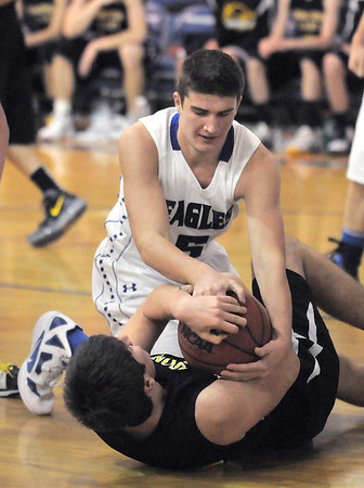 """Broomfield's Nate Roylance fights for control of the ball with Thompson Valley's Sam Baca during Thursday's game in the Eagle gym at Broomfield High.<br /> More photos please see  <a href=""""http://www.broomfieldenterprise.com"""">http://www.broomfieldenterprise.com</a><br /> December 15, 2011<br /> Staff photo/ David R. Jennings"""