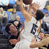 "Broomfield's Evan Kihn fights for the ball with Thompson Valley's Austin Dyer during Thursday's game in the Eagle gym at Broomfield High.<br /> More photos please see  <a href=""http://www.broomfieldenterprise.com"">http://www.broomfieldenterprise.com</a><br /> December 15, 2011<br /> Staff photo/ David R. Jennings"
