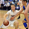Holy Family's David Sommers dribbles against Broomfield's Alec McLain during the cross town rivalry boys game at Holy Family on Friday.<br /> December 21, 2012<br /> staff photo/ David R. Jennings