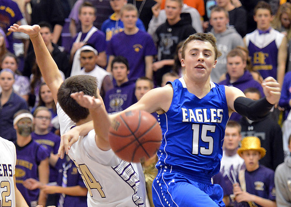 Broomfield's Evan Kihn collide with Holy Family's Devlin Granberg under the basket during Friday's cross town rivalry game at Holy Family.<br /> December 21, 2012<br /> staff photo/ David R. Jennings
