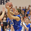 Broomfield's Brandon Hull reaches for the ball against Holy Family during the cross town rivalry boys game at Holy Family on Friday.<br /> December 21, 2012<br /> staff photo/ David R. Jennings