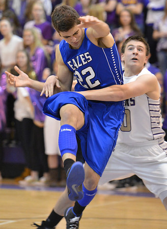 Holy Family's Alex Comeaux grabs Broomfield's Alec McLain under the basket during the cross town rivalry boys game at Holy Family on Friday.<br /> December 21, 2012<br /> staff photo/ David R. Jennings