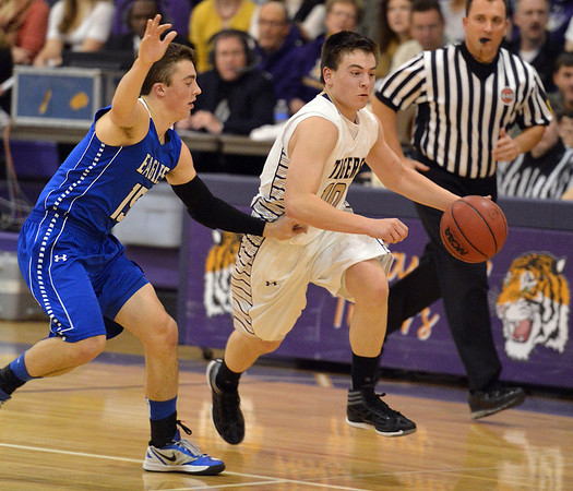 Holy Family's Alex Comeaux dribbles the ball past  Broomfield's Evan Kihn during the cross town rivalry boys game at Holy Family on Friday.<br /> December 21, 2012<br /> staff photo/ David R. Jennings