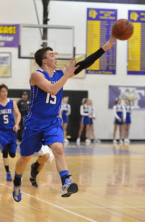Broomfield's Evan Kihn shoots a long shot against Holy Family during the cross town rivalry boys game at Holy Family on Friday.<br /> December 21, 2012<br /> staff photo/ David R. Jennings