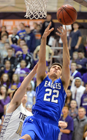 Broomfield's Alec McLain goes for the rebound against Holy Family's Alex Comeaux during the cross town rivalry boys game at Holy Family on Friday.<br /> December 21, 2012<br /> staff photo/ David R. Jennings