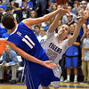 Holy Family's David Sommers tries to get to the basket against  Broomfield's Spenser Reeb during the cross town rivalry boys game at Holy Family on Friday.<br /> December 21, 2012<br /> staff photo/ David R. Jennings