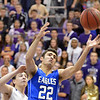 Broomfield's Alec McLain reaches for the rebound against Holy Family's Alex Comeaux during the cross town rivalry boys game at Holy Family on Friday.<br /> December 21, 2012<br /> staff photo/ David R. Jennings