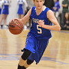 Broomfield's Chuck Hollwedel dribbles the ball downcourt again Holy Family during the cross town rivalry boys game at Holy Family on Friday.<br /> December 21, 2012<br /> staff photo/ David R. Jennings